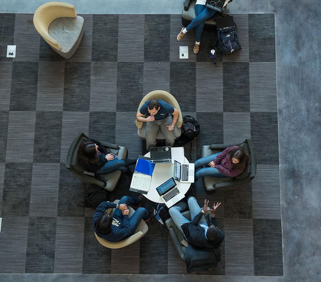 students sitting around table talking